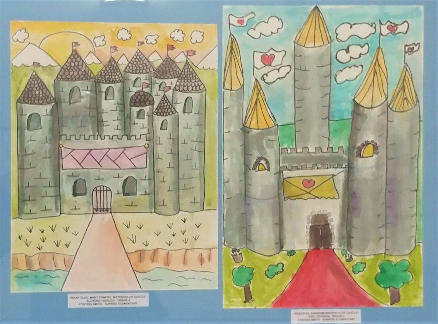 Peaceful Kingdom watercolor castle, by Itzel Estrada; right: Many Flag, Many Towers watercolor castle, by Alondra Hidalgo, both fourths grader at Sunrise Elementary School.