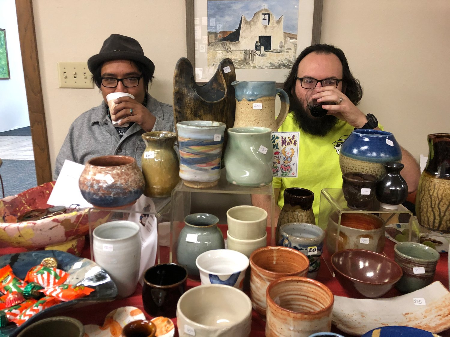 Potter Anthony Tarazoff with the Doña Ana Community College Student Arts Association, right, and artist Saba..