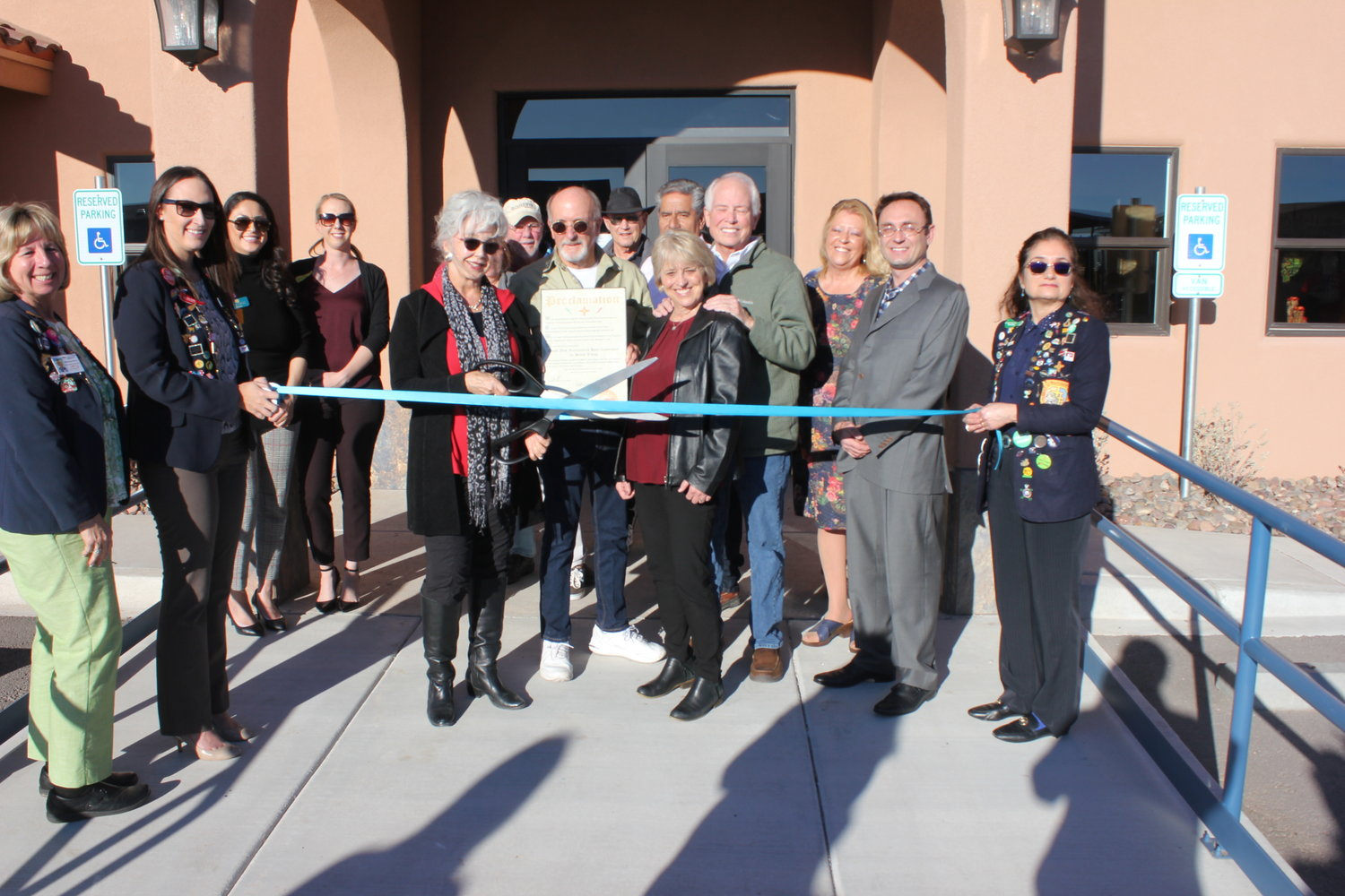 One of the Trails West Senior Community owners, Connie Hines, cuts the ribbon at the Greater Las Cruces Chamber of Commerce grand opening ceremony of Trails West's second clubhouse.