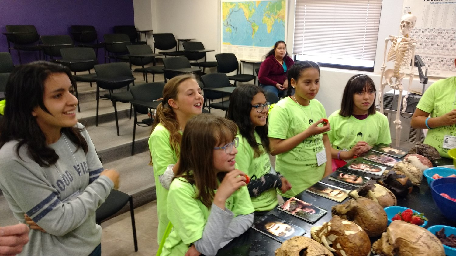 Professor Manda Clair Jost's anthropology workshop is always popular. In this photo, students eat different foods to learn about how human teeth, jaw bones, and jaw muscles evolved.