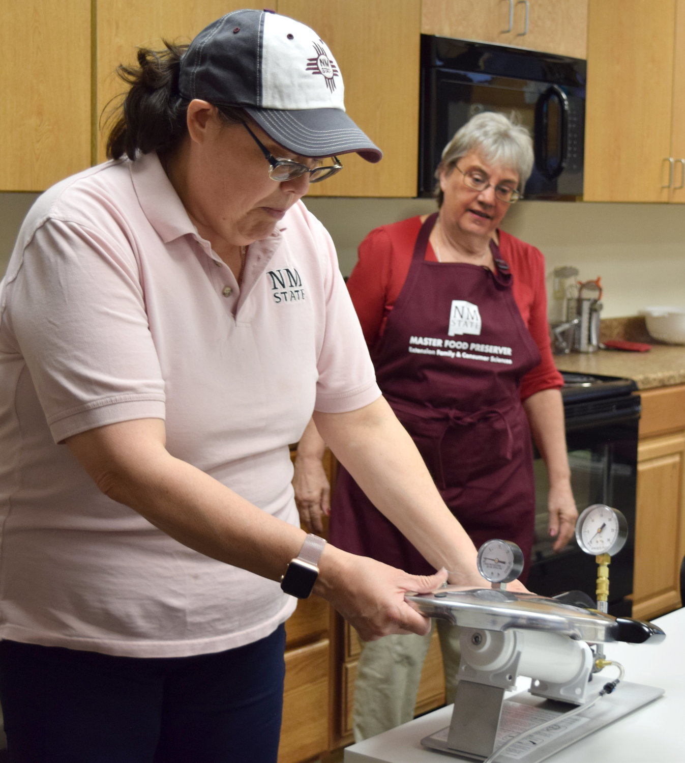 Nancy Flores, New Mexico State University Extension food technology specialist, demonstrates how to test