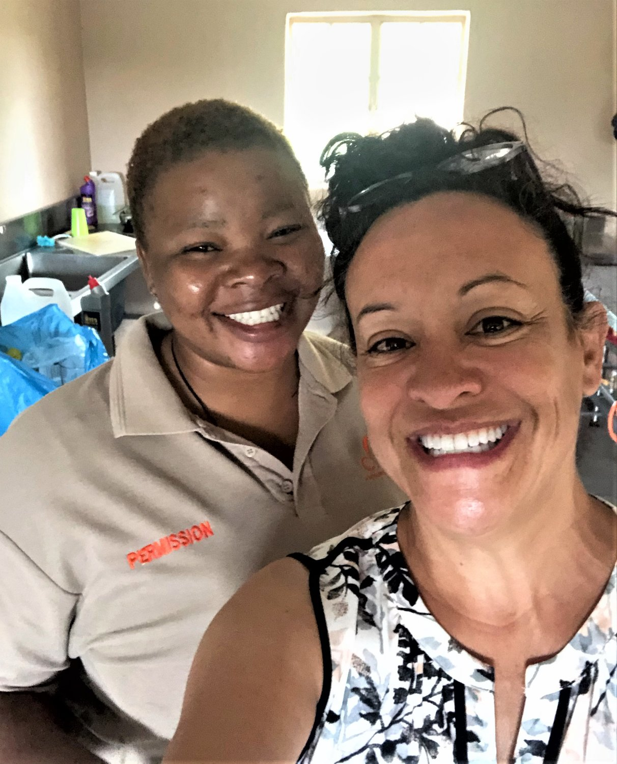 Cammy Montoya shares a light moment with staff member Permission Ngobeni as she says farewell to three weeks in South Africa.