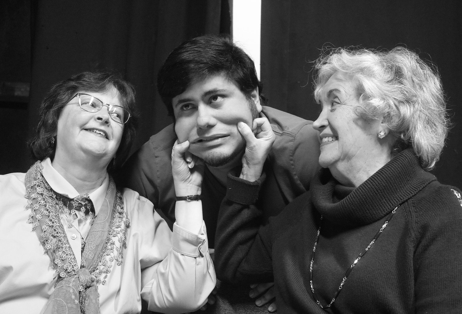 "Aunts Abby and Martha Brewster (Dawn Duncan and Virginia Ostendorf) dote on nephew Mortimer (Luz Francisco Resendez) in ""Arsenic and Old Lace,"" which opens Friday, Jan. 31, at Las Cruces Community Theatre."