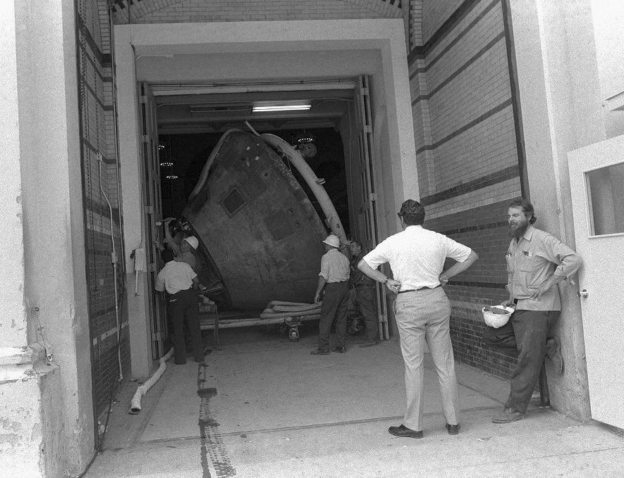Columbia, the Apollo 11 Command Module, is gently eased out of the Arts and Industries Building on its way to the new National Air and Space Museum in 1975. The tight squeeze highlights how the simplest things, like door size, can become major challenges.