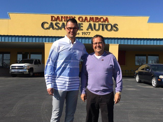 Danny and Gabriel Gamboa at the dealership Danny established in 1977.