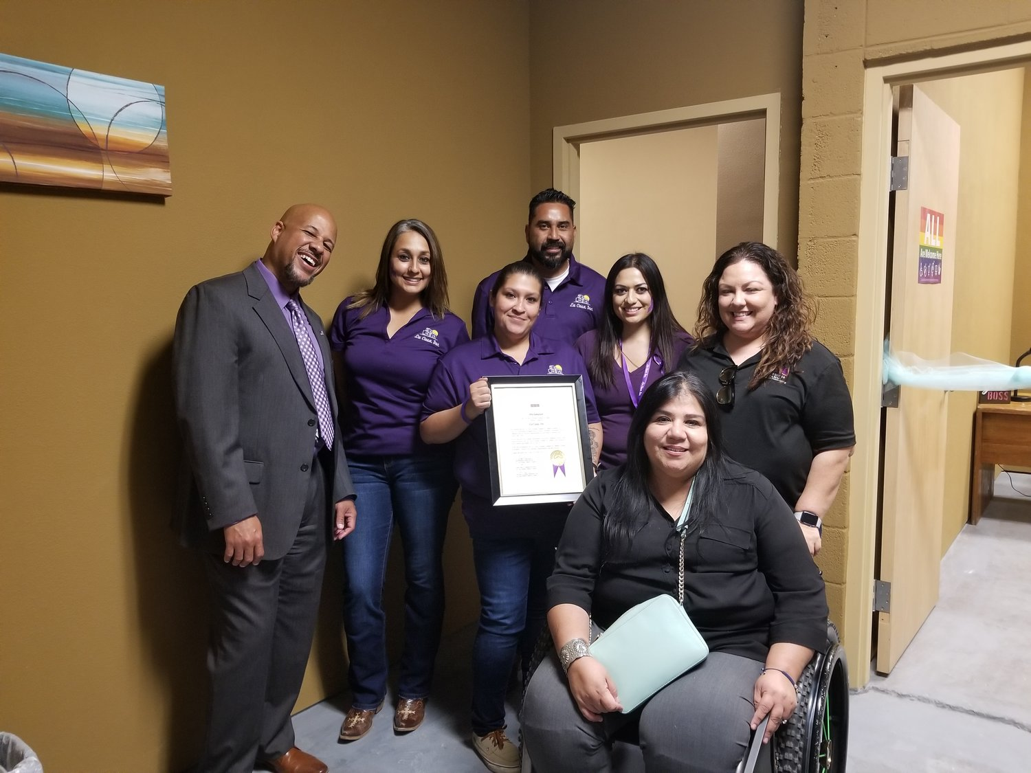 La Casa's Anthony, New Mexico staff and board member Berna Tirre (standing, far right) with Anthony Mayor Diana Murillo Trujillo (seated at right). Standing from left are La Casa Executive Director Henry Brutus, Case Manager Ceci Pinales, South Valley Program Coordinator Juliana Hernandez, Domestic Violence Advocate Jessica Solis and Rural Outreach Advocate Victor Soriano.