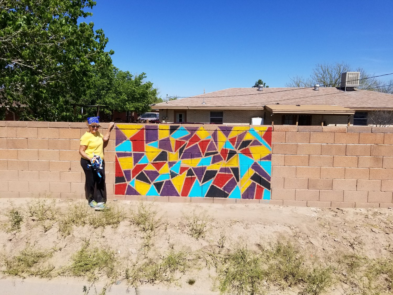 Ginny May of Las Cruces with her Art With Heart creation.
