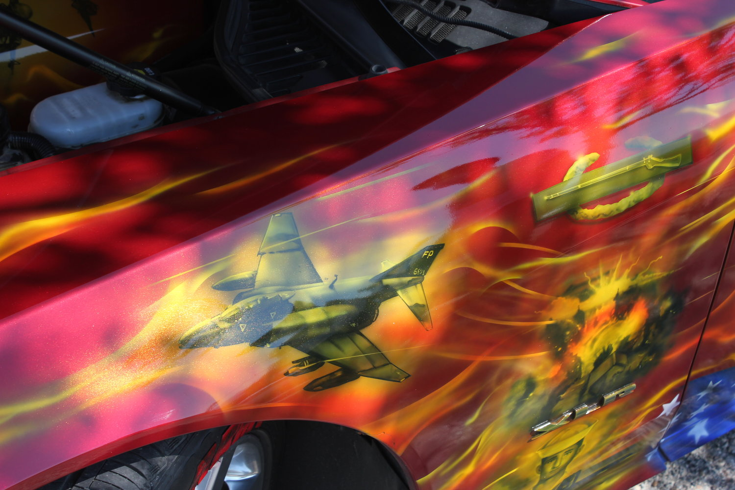 Among Luis Navarro's artwork is this depiction of a Vietnam-era F-4 fighter.