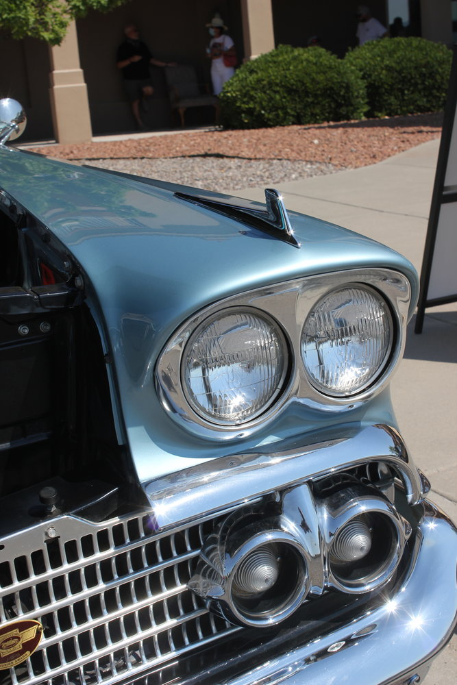 A closeup of the headlamps on a 1958 Chevrolet Impala.