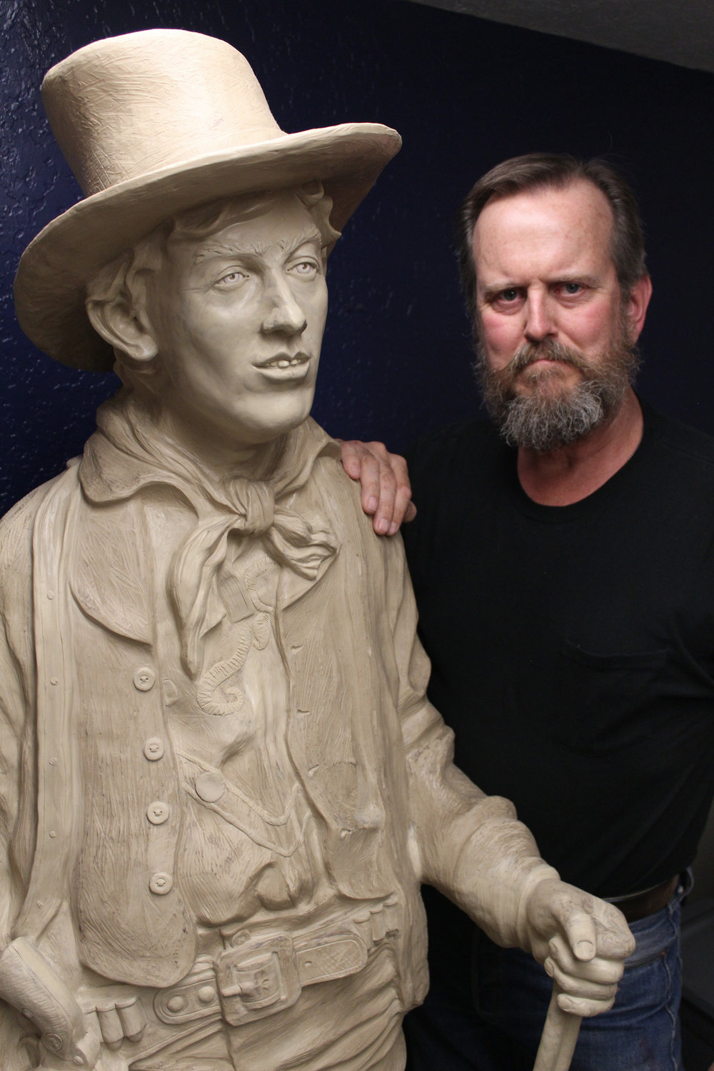Las Cruces artist Bob Diven and his sculpture of Billy the Kid. Diven is on the right.