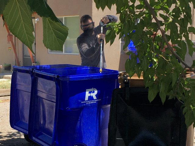 Las Cruces entrepreneur Keith Kalson cleans residential trash receptacles as one of the services offered by his new business, New Mexico Under Pressure.