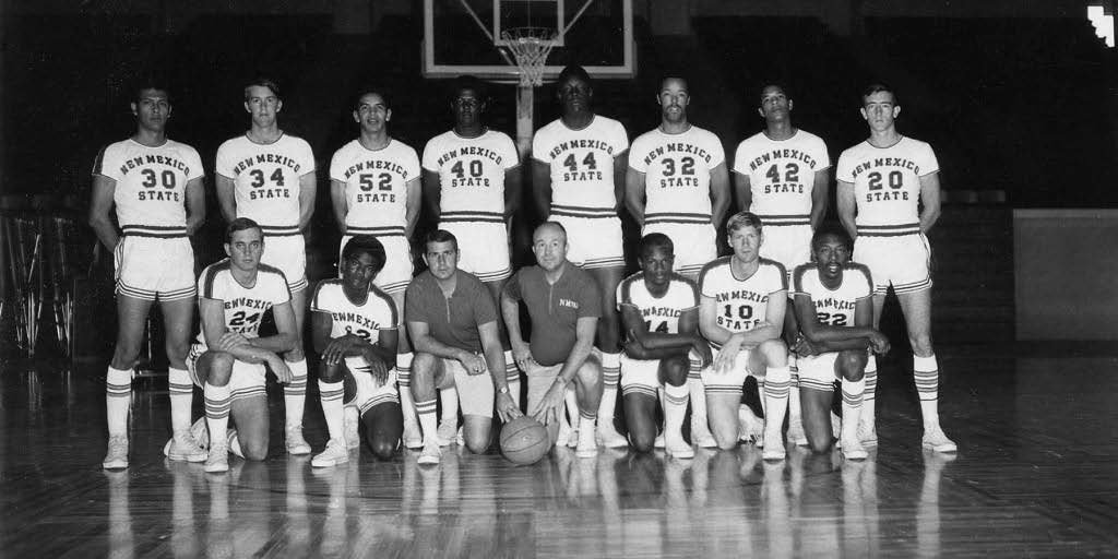 This photo of the 1969-70 New Mexico State University Aggie men's basketball team appeared in the very first edition of the Las Cruces Bulletin, Dec. 4, 1969, as part of a season preview. It has appeared a few times since, because this is the Aggie team that reached the Final Four in that year's NCAA tournament. FRONT ROW: Eddie Huff, Milton Horn, Assistant Coach Keith Colson, Head Coach Lou Henson, Charlie Criss, Tom McCarthy, Jimmy Collins. BACK ROW: Rudy France, John Burgess, Chito Reyes, Jeff Smith, Sam Lacey, Lonnie Lefevre, Roy Neal, Bill Moore.