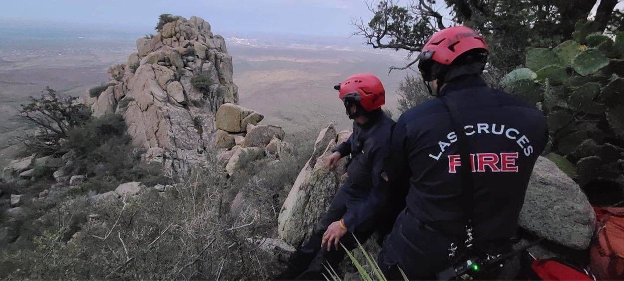 Las Cruces firefighters assess the terrain during a July 20 rescue mission to extract three hikers from the Organ Mountains.