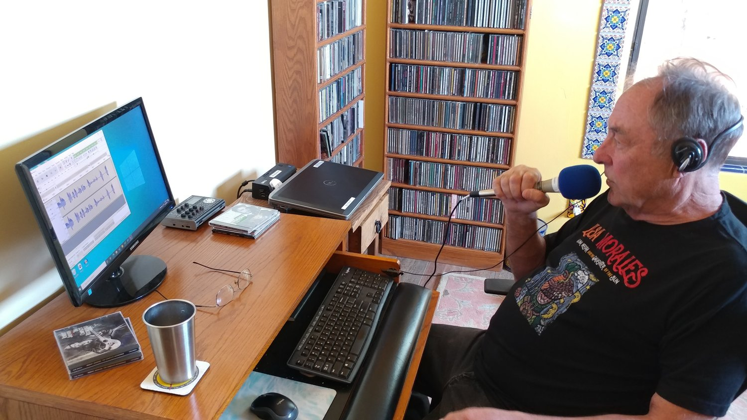"Marty Racine in his home studio, recording the third hour of his sixth ""Cross City Blues"" radio show."