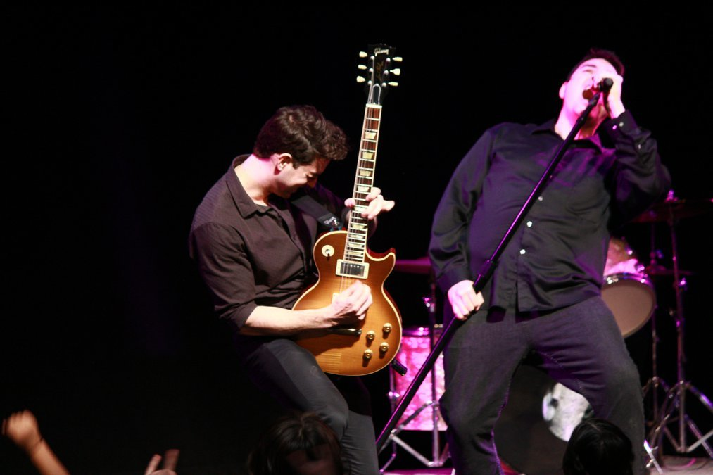 Mark Klett, left, playing guitar with James Gier.