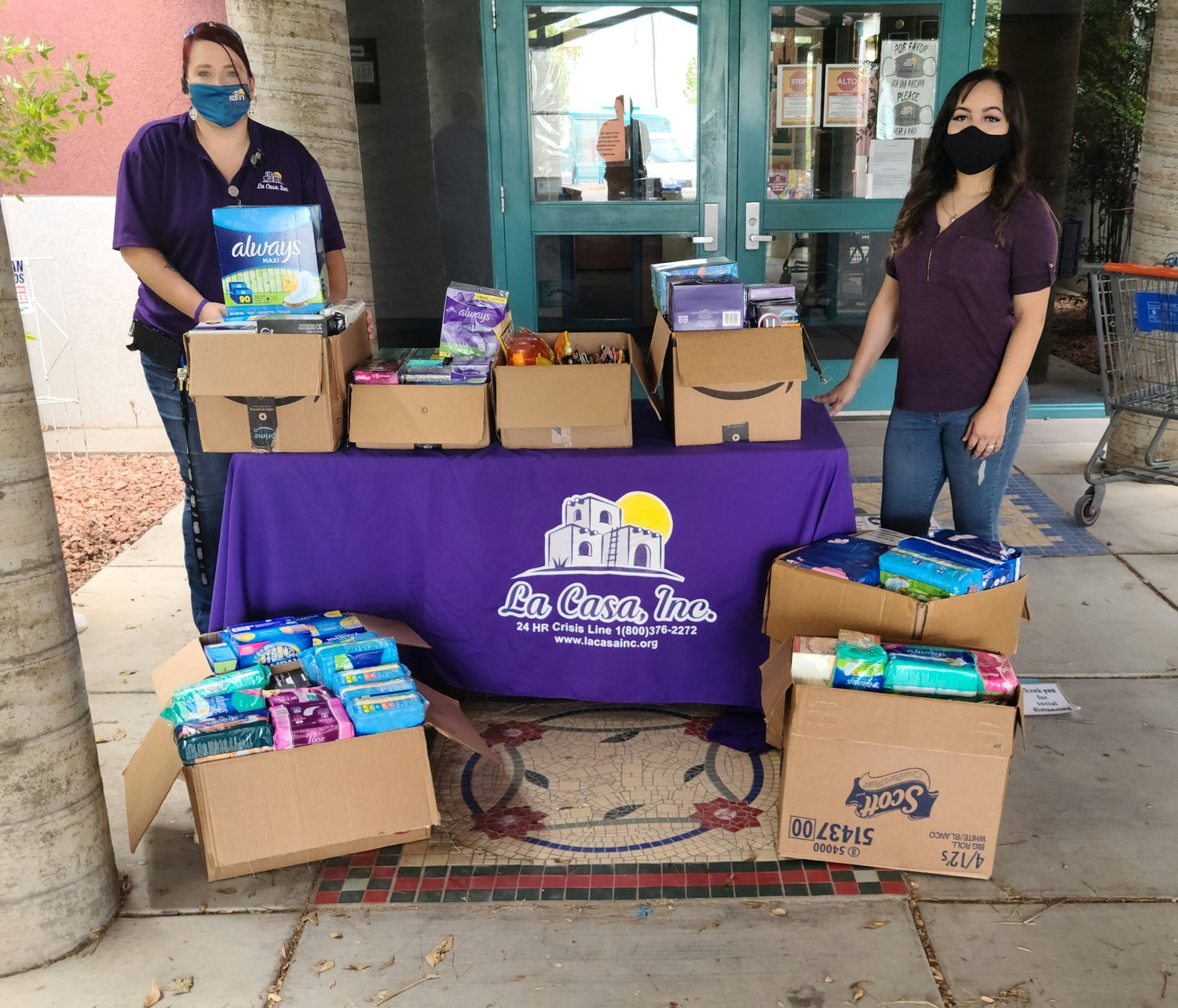 La Casa, Inc. Event and Volunteer Manager Pamela Cisneros and South Valley (Anthony, New Mexico) Advocate Jessica Solis staging a donation event related to COVID.
