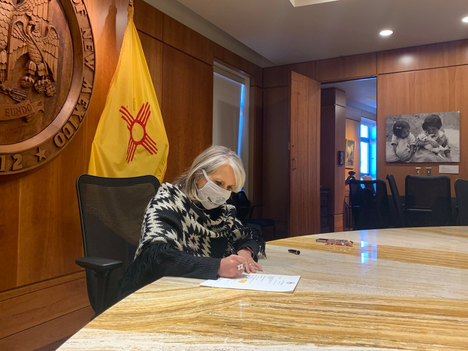 Gov. Michelle Lujan Grisham on Wednesday signed into law a significant relief package for New Mexicans that will deliver grants to small New Mexico businesses, supplemental payments to the unemployed and other emergency food and housing relief.