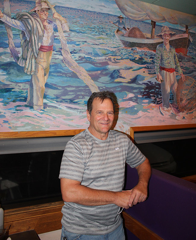 Vince Vaccaro, owner of Las Cruces' Lorenzo's Restaurant, poses in front of a mural at the restaurant, which depicts a Sicilian scene in which the fisherman's face looks somehow familiar.