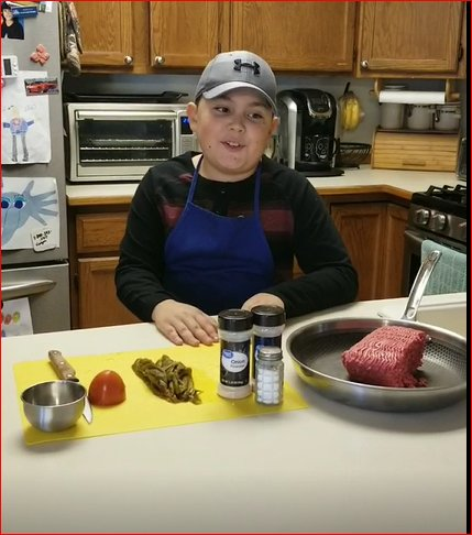 "Doña Ana Elementary School fifth grader Gabriel Whitefield ""makes the cleverest cooking shows,"" said teacher Barb Ericson. In this photo, he is making green chile stew."