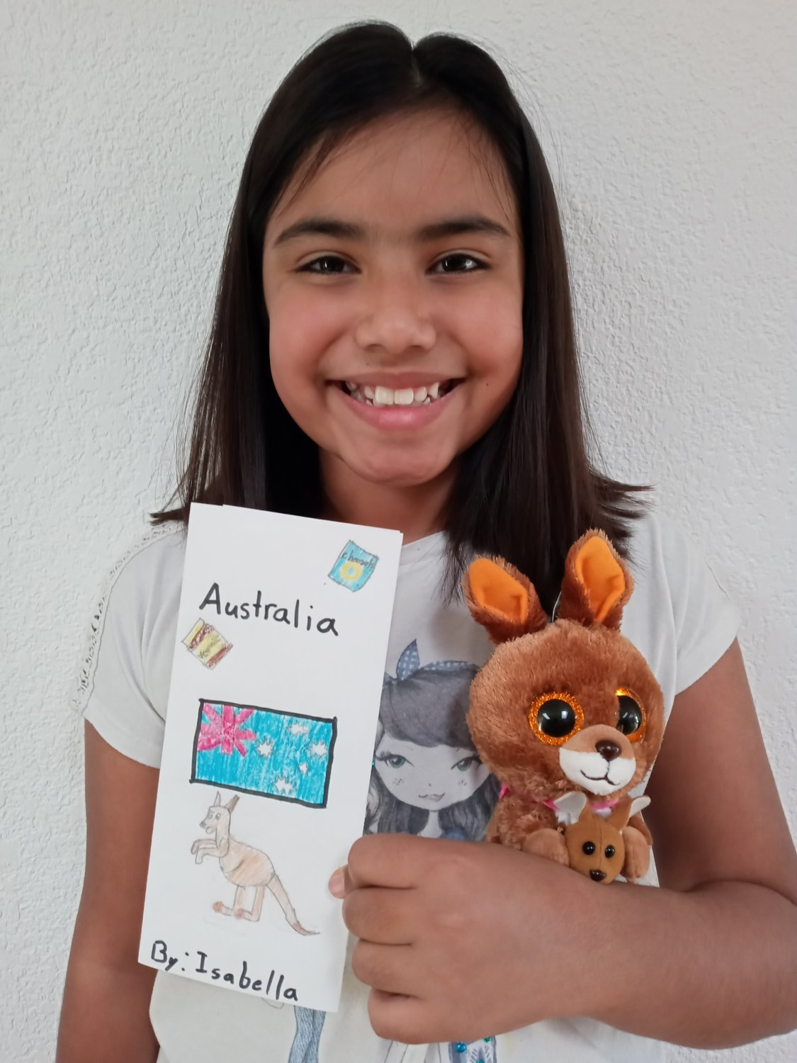 Doña Ana Elementary School fourth grader Isabella Jasso with the brochure she made about Australia.