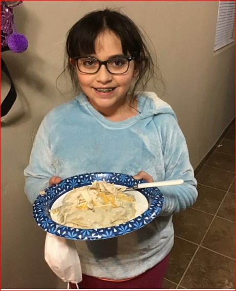 Alyssa Torres, a fourth-grade student at Doña Ana Elementary School, made green chile enchiladas as part of her study of other countries and cultures.