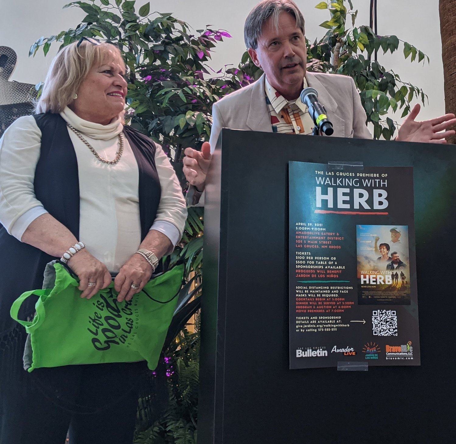 "Las Cruces Bulletin Publisher Richard Coltharp introduces and reads a poem written by Bulletin reporter Mike Cook as marketing consultant Elaine Sasnow looks on during the Las Cruces premier of ""Walking with Herb."""