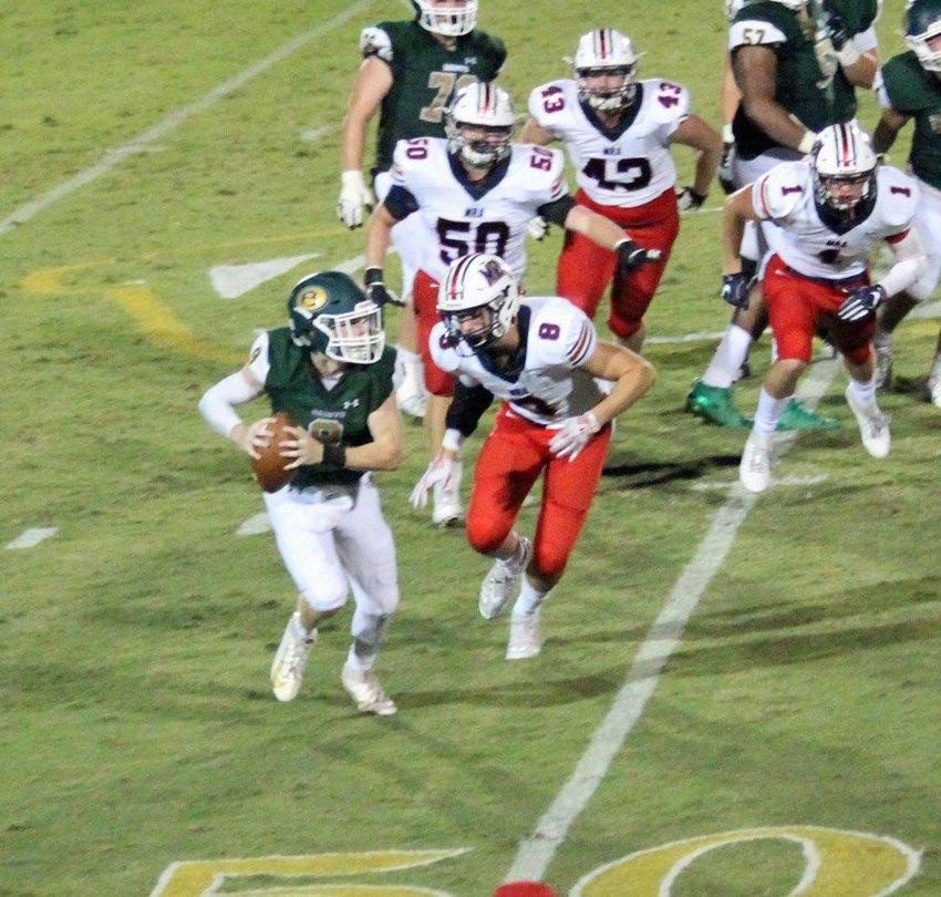 MRA defenders swarm the Briarcrest quarterback.
