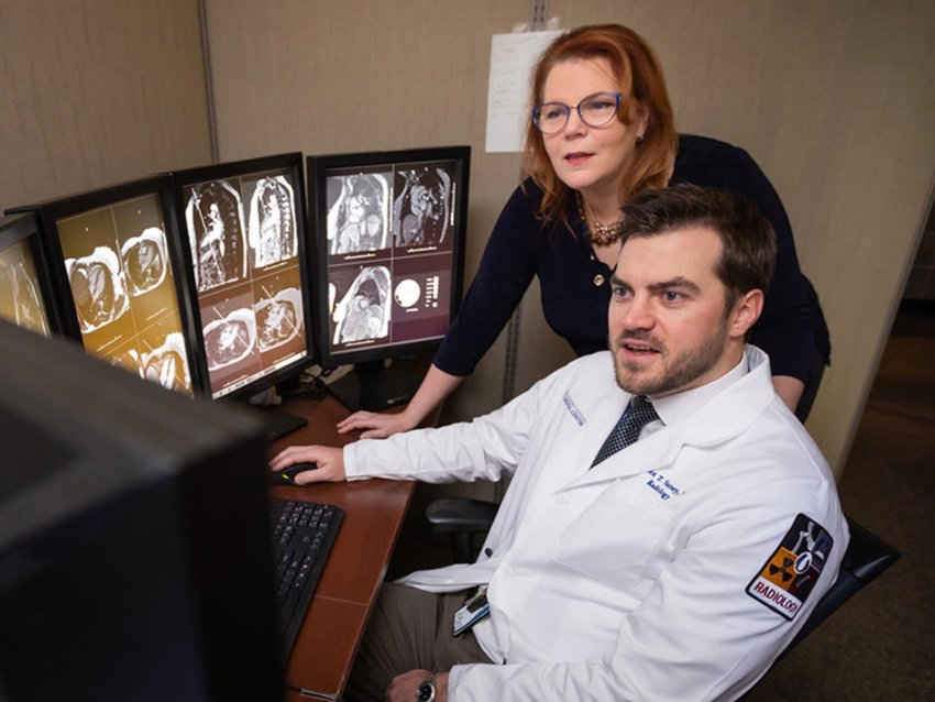 """Dr. Elliot Varney of Madison, foreground, is """"the perfect inaugural candidate"""" for the new Ph.D. program, says Dr. Candace Howard-Claudio of Ridgeland, background, the program's director."""