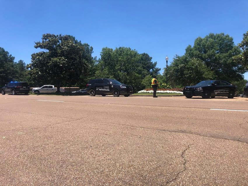 A heavy police presence blocked traffic in and out of Cypress Lake Friday during a standoff with a woman who refused to open her door for a court order.