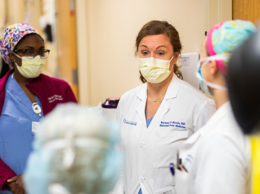 Dr. Rachael Morris of Madison, center, UMMC associate professor of obstetrics and gynecology and a maternal-fetal medicine specialist, leads rounds on the Labor and Delivery floor.