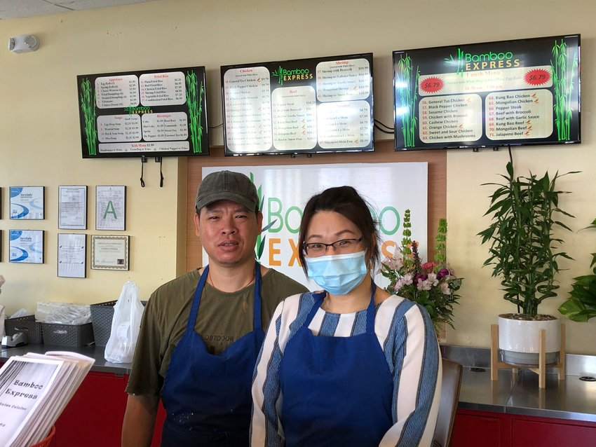 Jide Kuang and his sister Michelle Wong man the counter at the new Bamboo Express in Gluckstadt.