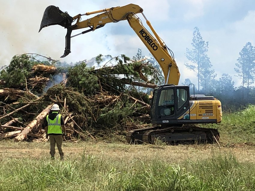 Construction crews on Wednesday were using heavy equipment to do dirt work and clear trees throughout parts of the Madison County Mega Site. Construction of a new $60 million Entergy substation is expected to begin in December. In addition, a large warehouse facility is planned for 69.02 acres of land recently purchased by Amazon.