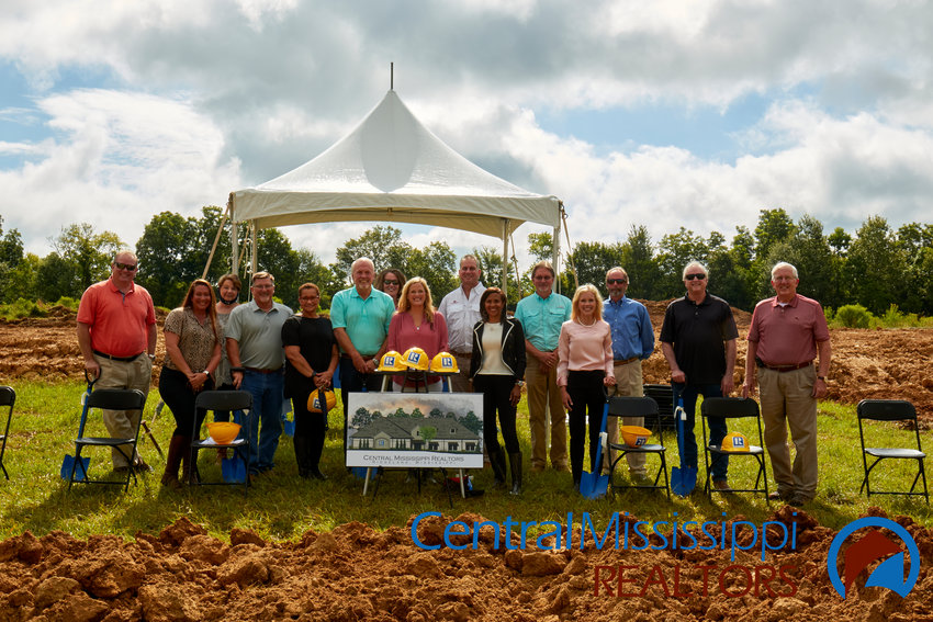 The Central Mississippi Realtors Association recently held a private groundbreaking ceremony for a new office in Ridgeland next to Patty Peck.