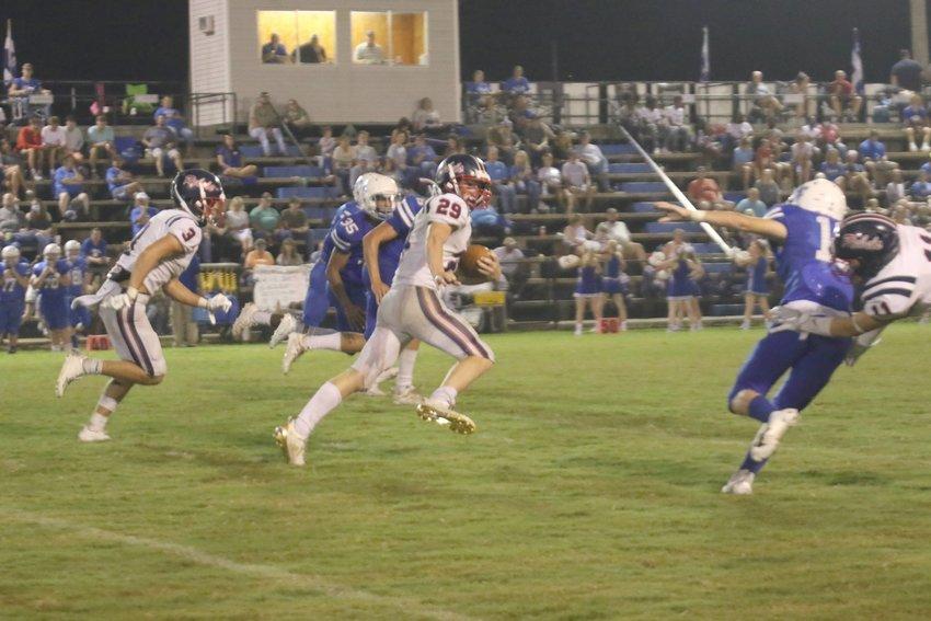 #29 Zac Clark scrambles down the field as #3 Eli Hamlin rushes to help block.