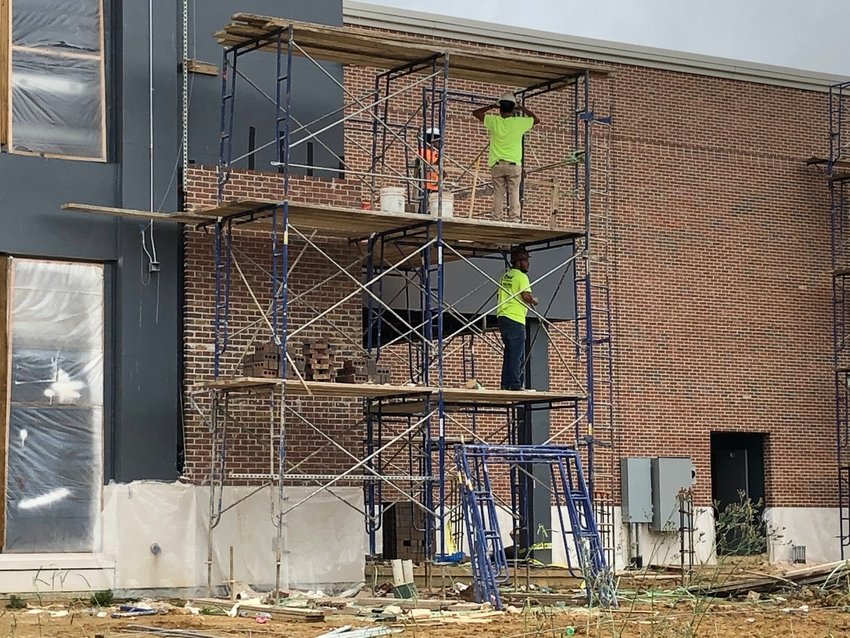 Bricklayers continue on the exterior layer of the new Ridgeland City Hall building one July morning prior to afternoon thunderstorms. The new City Hall building, located at the corner of U.S 51 and School Street, is set to open in February. The two-story, 30,000-square foot building will be the first at the new City Center site. The pricetag for the Center currently stands at $15.9 million. Also planned for the area is a Veteran's Memory Park approved in April 2017.