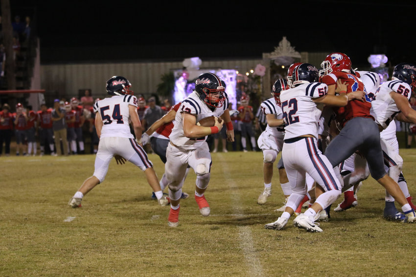 #12 Trace Dearman, blocking by #52 Aiden Barker, #56 Reed Marberry, and #51 Crosby Mohamed