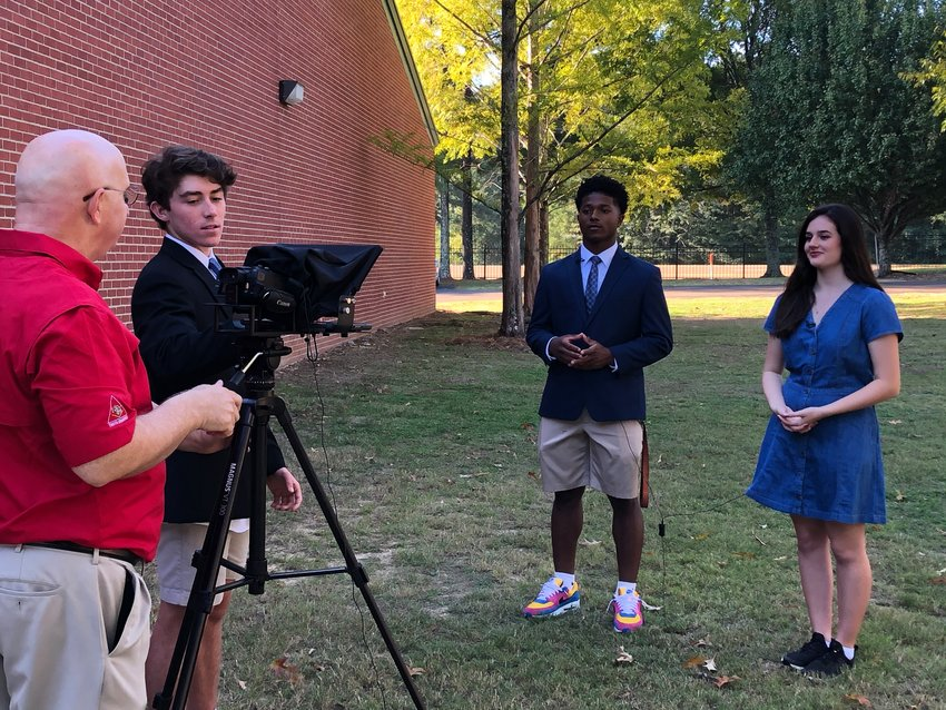 Terry Cassreino and students from his sophomore class film for St. Joe's weekly newscast, Bruin News Now. Pictured from left to right are Terry Cassreino, Harrison Mohead, Kevin May, and Gia Picarella.