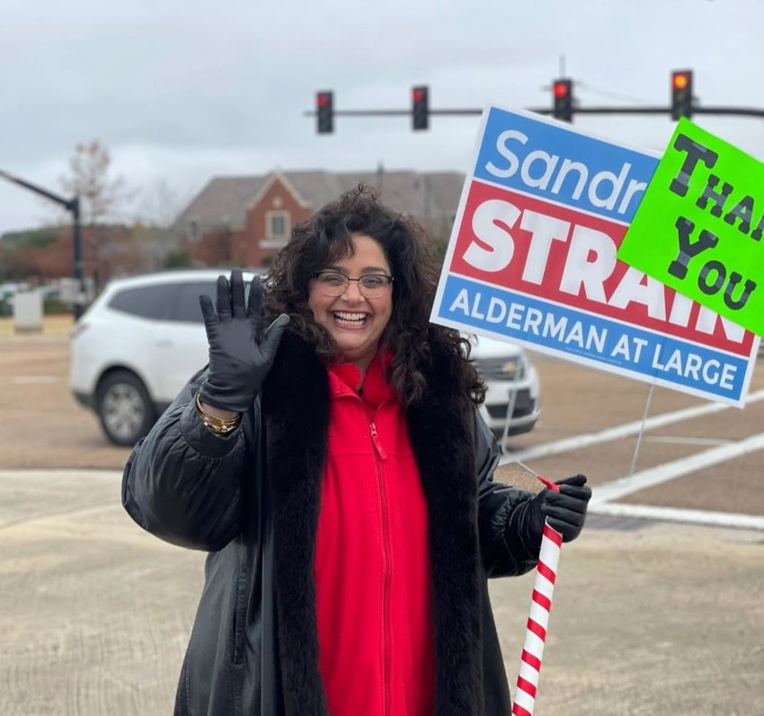"Strain added ""thank you"" signs to some of her campaign signs to show her gratitude for those who voted."