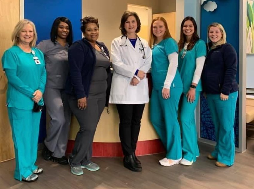 Staff members of the brand-new TrustCare Kids clinic stand together as a team. Pictured from left to right: Nurse Paula Murphy, Akera Shephard (Patient Registration Representative), Korlynn Trice (Director of Revenue Cycle Management), Dr. Catherine Phillippi (Head Pediatrician), Nurse Margaret Bufkin, Nurse Hannah Ivey, and Shelby Johnson, Nurse Practitioner.