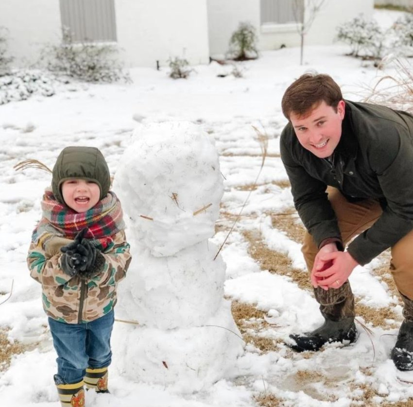 Whit Dehmer, 3, enjoys the snow in Gluckstadt on Monday with his dad Steele. Madison County received and estimated 2 inches of snow early Monday morning, according to the National Weather Service.