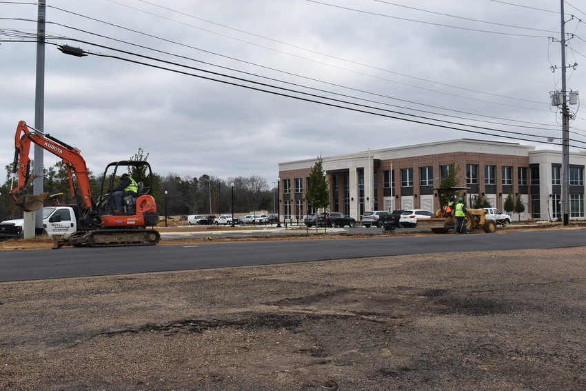 City officials spent Monday moving into a new $15.9 million, 30,000-square-foot City Hall as contractors worked outside to wrap up final curb work.