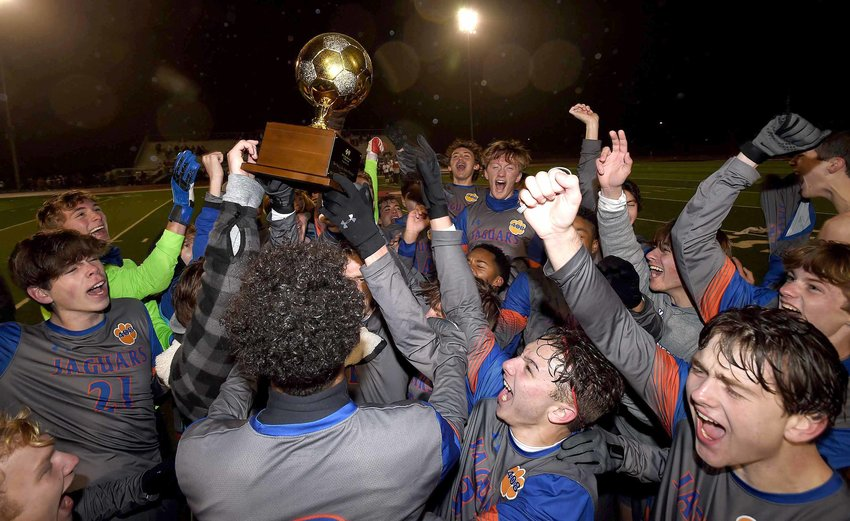 The Madison Central Jaguars celebrate after beating Brandon in the MHSAA Class 6A State Soccer Championship on Saturday, February 6, 2021, at Clinton High School in Clinton, Miss.