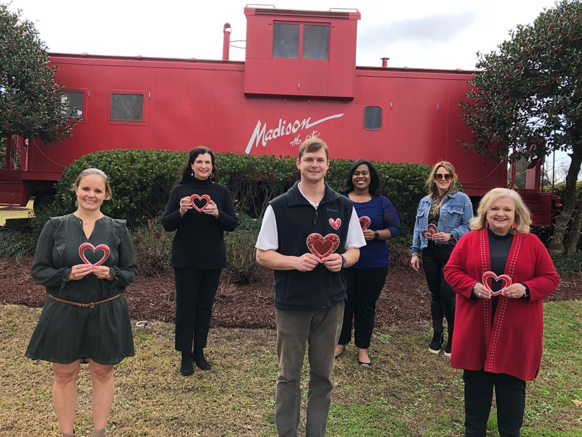Members of the Madison the City Chamber of Commerce show their love for local businesses with their Lovin' Local campaign. Pictured, from left to right: Kristen Lambert, membership operations director; Elizabeth Fulche, executive director; Landon Thompson, president; Felichia Fields, board member; Genia Quinns, administrator assistant; and Matha House, treasurer.