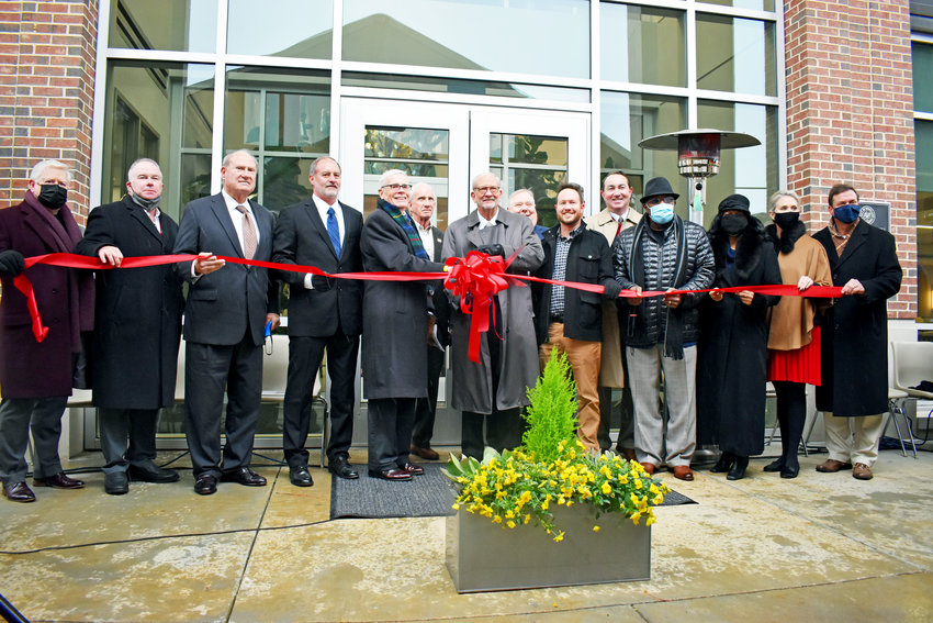 Ridgeland Mayor Gene F. McGee, flanked by officials and dignitaries, cuts the ribbon during Sunday's Ridgeland City Hall Dedication Ceremony..(Scott Hawkins, The Madison County Journal)