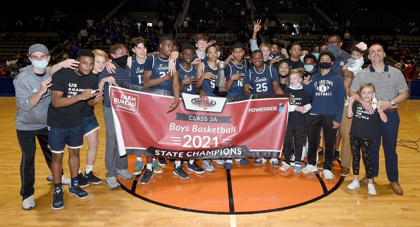 The St. Andrew's Saints pose for pictures after winning the MHSAA Class 3A State Basketball Championship on Saturday, March 6, 2021, at the Mississippi Coliseum in Jackson, Miss.
