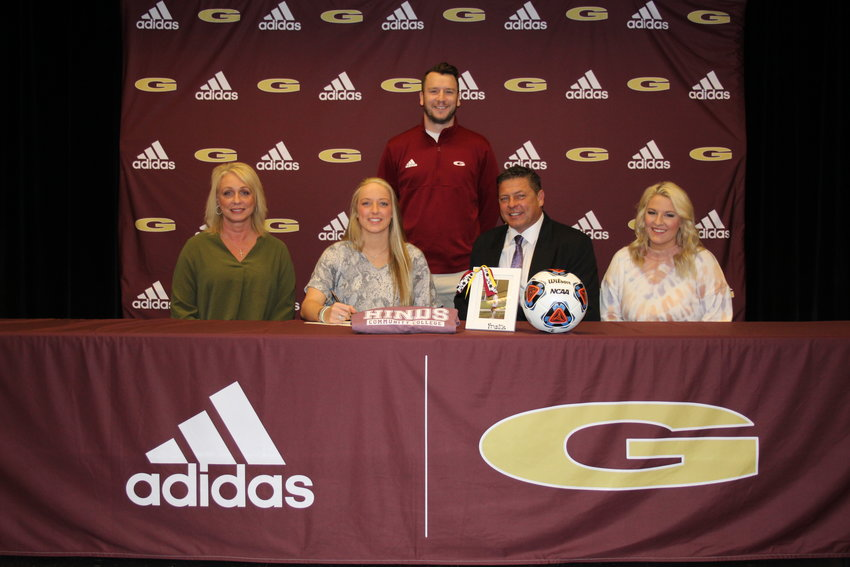 Pictured with Frankie are parents, Kim and John Wood, and sister Hannah. Head Girls Soccer Coach J.T. Coward is also pictured.