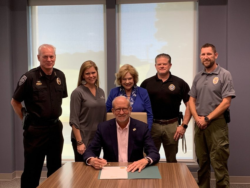 Ridgeland Mayor Gene McGee signs a proclamation designating May 9 – 14, 2021, National Law Enforcement Appreciation Week. The Ridgeland Chamber of Commerce will host several events to honor Ridgeland's 65 sworn officers.From left, Ridgeland Chief of Police John Neal; Kristy Daniels, PriorityOne Bank and Ridgeland Police Appreciation Week chair; Linda Bynum, Ridgeland Chamber Executive Director; Brian Myers, Lieutenant of Patrol and Eddie Addison, Lieutenant of Criminal Investigations.