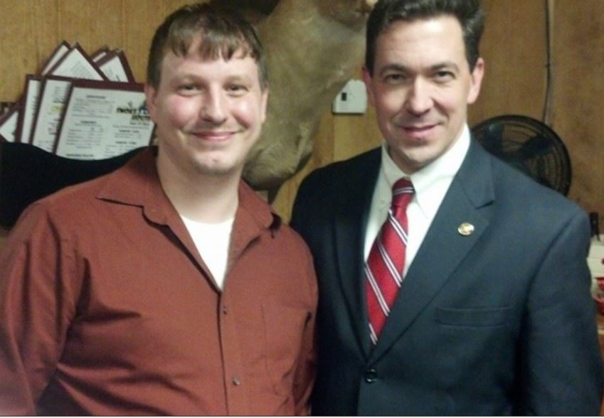 Clayton Kelly, one of the accused in the Cochran nursing home scandal, with state Sen. Chris McDaniel at a campaign function in 2014.