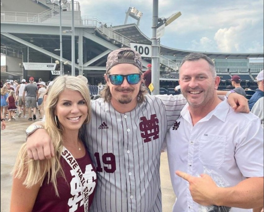 Brooks Bryan of Madison and his wife Beth are pictured with Michael Hardy, center, known to country music fans as Hardy, another former Neshoba County resident, at the College World Series in Omaha Nebraska.
