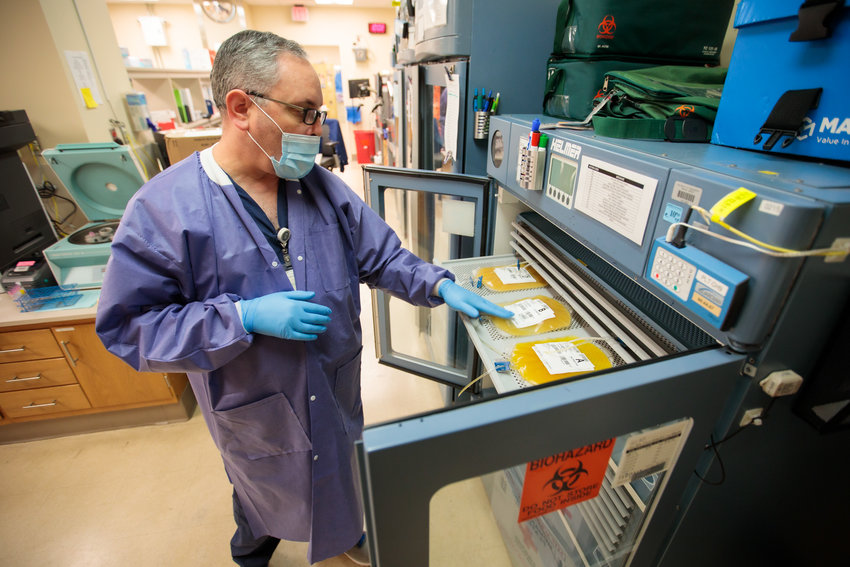 Vince Morton, a medical technologist who lives in Madison, checks the inventory of platelets stored at UMMC's blood bank.